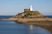 Lighthouse at low tide Mumbles Head, Gower peninsula, near Swansea, South Wales, UK