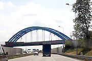 Arch supported bridge over the freeway. Warsaw Poland
