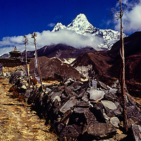 Ama Dablam Peak with Mani (prayer) wall and prayer flags on Everest Trek.