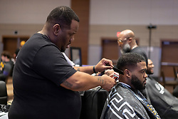 Members of the LSU Tigers have their hair cut at their team hotel on Thursday, Dec. 26, in Atlanta. #4 Oklahoma will face #1 LSU in the 2019 College Football Playoff Semifinal at the Chick-fil-A Peach Bowl on Saturday, Dec. 28, 2019. (Paul Abell via Abell Images for the Chick-fil-A Peach Bowl)
