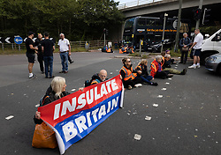 © Licensed to London News Pictures. 29/09/2021. Swanley, UK. Insulate Britain activists block the road near to junction 3 of the M25 motorway near Swanley for the second time today. 11 members of the campaign group were detained at the same junction earlier today. This is the seventh time in just over two weeks that activists have disrupted traffic on London's orbital motorway despite the government being granted a temporary High Court Injucntion banning the group from protesting on the M25. 50 protesters who were detained after Monday's protest, on junction 14 of the M25 at Heathrow, were released. Photo credit: Peter Macdiarmid/LNP