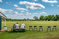 Ulgham, Morpeth, Northumberland, England, UK. 12th June 2021. Ulgham Cricket Club in rural Northumberland on a pleasant summers afternoon. The team were hosting Wooler CC.