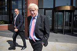 © Licensed to London News Pictures. 12/07/2019. London, UK. Conservative Party leadership candidate BORIS JOHNSON is seen leaving a BBC interview in Westminster, London. Later this month the Conservative Party will select a new leader and Prime Minister, following Theresa May's announcement that she will step down. Photo credit: Ben Cawthra/LNP