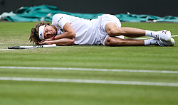 LONDON, July 6, 2018  Alexander Zverev of Germany lies on the court after slipping during the men's singles second round match against Taylor Fritz of the United States at the Wimbledon Championships 2018 in London, Britain, on July 5, 2018. (Credit Image: © Shi Tang/Xinhua via ZUMA Wire)