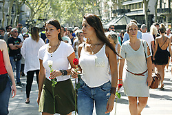 August 18, 2017 - unknown - Barcelona, Spain, August 18, 2017 : Barcelona citizens holding a rose for the minute of silence held at Plaza Catalonia on the day after a terrorist white van running over tourist pedestrians walking down the Rambla on August 17, 2017 around 05:00pm. Photo credit : Marc Javierre-Kohan / Aurimages (Credit Image: © Marc Javierre Kohan/Aurimages via ZUMA Press)