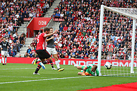 Football - 2018 / 2019 Premier League - Southampton vs. Burnley<br /> <br /> Southampton's Jack Stephens gets on the end of a deep cross and forces Joe Hart of Burnley into a smart save at St Mary's Stadium Southampton<br /> <br /> COLORSPORT/SHAUN BOGGUST