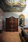 confessional in an elegant baroque style church Italy