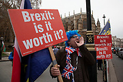 Anti Brexit pro Europe demonstrator protests with Brexit is it worth it placards in Westminster opposite Parliament on the as five days of Brexit debate begins on 4th December 2018 in London, England, United Kingdom.