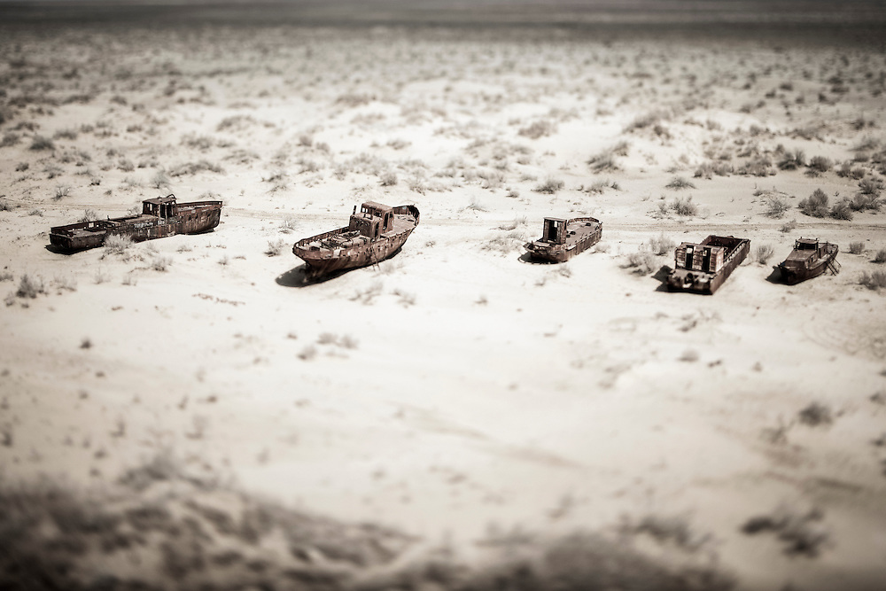 """Moynaq, Uzbekistan 29 March 2012<br /> View of the the boat cemetery in the Aral sea.<br /> The Aral sea was a lake that lay between Kazakhstan in the north and Karakalpakstan, an autonomous region of Uzbekistan, in the south. <br /> The name roughly translates as """"Sea of Islands"""", referring to more than 1,534 islands that once dotted its waters.<br /> Formerly one of the four largest lakes in the world with an area of 68,000 square kilometres, the Aral Sea has been steadily shrinking since the 1960s after the rivers that fed it were diverted by Soviet irrigation projects. By 2007, it had declined to 10% of its original size.<br /> PHOTO: EZEQUIEL SCAGNETTI"""