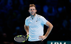 Jack Sock smiles towards the end of the second set during day three of the NITTO ATP World Tour Finals at the O2 Arena, London.