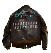 """This type A-2 flight jacket belonged to Nevin G. Kauffman, a ball gunner attached to the 571st squadron of the 390th Bomb Group. On the front of the jacket is the name plate which reads """"N.G. Kauffman Ball Gunner"""". On the back of the jacket is the name of Kauffman's aircraft """"Cincinnati Queen"""". Below the aircraft's name there are 30 bombs painted for each mission that Kauffman successfully flew. The """"Cincinnati Queen"""" was labeled MIA after a mission on June 21, 1944."""