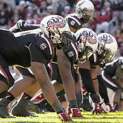 The South Carolina Gamecocks defense lines up with custom-made helmets against Florida during an SEC college football game n Columbia, S.C. ©Travis Bell Photography