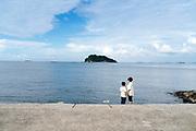 mother with son at Umikaze park, Yokosuka with Tokyo Bay and Sarushima Island
