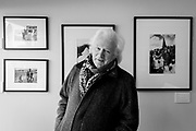 A portrait of documentary photographer, Homer Sykes while at his exhibition of his 'Once a Year: Some Traditional British Customs' work, being shown at the Lucy Bell Gallery in St Leonards, on 3rd May 2021, in St Leonards, Sussex, England.