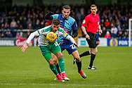 Wycombe Wanderers defender Charlie Fox (27) battles with Plymouth Argyle midfielder Graham Carey (10) during the EFL Sky Bet League 1 match between Wycombe Wanderers and Plymouth Argyle at Adams Park, High Wycombe, England on 26 January 2019.