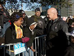 09 February 2010. New Orleans, Louisiana, USA. <br /> Mayor Landrieu and his son greets fans. Saints Mania captures New Orleans like no other parade. The New Orleans Saints victorous NFL football team makes its way from the Superdome through the city. Drew Brees and the crew make their way through screaming fans. The team salutes the massed crowds along the victory parade route in downtown New Orleans following the team's stunning victory over the Indianapolis Colts for Superbowl 44. <br /> Photo©; Charlie Varley. Varleypix.com