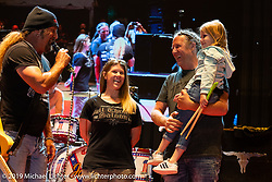 Full Throttle Saloon's Angie and Michael Ballard on the Main Stage with their daughter as they get honored by Jesse James Dupree for the FTS 20th anniversary on Jackyl night at the Full Throttle Saloon during the Sturgis Black Hills Motorcycle Rally. SD, USA. Thursday, August 8, 2019. Photography ©2019 Michael Lichter.