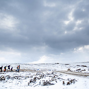 In subfreezing snowy weather, refugees walk the unoffical refugee  route across Serbia.  A daily average of 2,200 refugees have crossed into Serbia throughout the winter.  Warmer months saw highs of 10,000 arrivals. They have escaped their own country in conflict, taken a perilous boat ride from Turkey to Greece, and then moved onward through disorienting foreign lands in search of a peaceful home. Most refugees are headed to welcoming Germany. They are from  Afghanistan, Iraq, and Syria, with a wide range of socioeconomic backgrounds. Economic migrants also arrive in Macedonia and Serbia, but without the proper papers they are turned back, while some find smugglers to take them further into Europe. Near Miratovac, Serbia, January 2016. Produced for Mercy Corps.