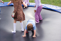 Children playing on a trampoline,