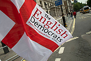 The English Democrats flag in London, United Kingdom. The English Democrats is an English nationalist political party in England. In its 2016 manifesto, the party proposed a devolved English Parliament, instead of its 2014 suggestion that England should become an independent country.