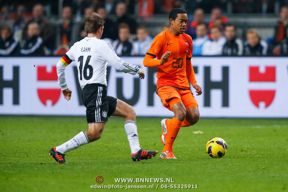 NLD/Amsterdam/20121114 - Vriendschappelijk duel Nederland - Duitsland, Urby Emanuelson in duel met Phillip Lahm