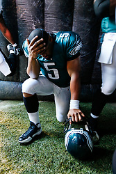 Philadelphia Eagles quarterback Donovan McNabb #5 takes a knee before entering the field before the NFL game between the Denver Broncos and the Philadelphia Eagles on December 27th 2009. The Eagles won 30-27 at Lincoln Financial Field in Philadelphia, Pennsylvania. (Photo By Brian Garfinkel)