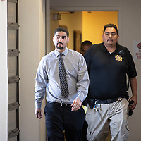 Ryan Westman is escorted out of a courtroom at the McKinley County Courthouse after jury selection, Tuesday, June 18 in Gallup.