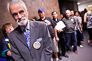 22 FEBRUARY 2011 - PHOENIX, AZ: George Sprankle (CQ) (BEARDED MAN) and other supporters of the Tea Party movement wait to get into the Senate Appropriations committee hearing room at the State Capitol in Phoenix Tuesday. Hundreds of people including supporters of immigrants' rights, supporters of border defense, motorcycle riders and members of the Tea Party, converged on the capitol to express their views on bills.      PHOTO BY JACK KURTZ