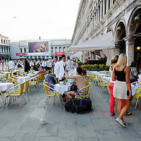 Venice August 20 A couple ask the bill at a waiter of the Laven Cafe. A group of Italian tourists were horrified to be charged the equivalent of £85 for four espresso coffees laced with liqueurs in the very central Saint Mark's Square in  Venice.