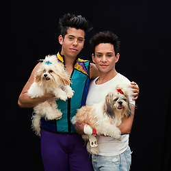 """Portrait of Jose Aston Neves and his partner Andrei Ricardo Peixotode Oliveira with their dogs. The couple work as a dancer and trapeze flier respectively.<br /> <br /> After 146 years, the """"Greatest Show on Earth"""" will close its curtain in the end of May. <br /> Ringling Bros. and Barnum & Bailey Circus started in 1919 when the circus created by James Anthony Bailey and P. T. Barnum merged with the Ringling Brothers Circus. The circus' parent company, Feld Entertainment, made the decision to end the show after waning ticket sales and long court battles over the treatment of animals, particularly the elephants, made the costly entertainment event unsustainable."""