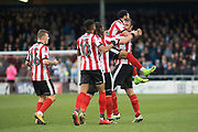 Lincoln City celebrate as Lincoln City Forward Matt Rhead scores a goal 1-0 during the EFL Sky Bet League 2 match between Lincoln City and Coventry City at Sincil Bank, Lincoln, United Kingdom on 18 November 2017. Photo by Craig Zadoroznyj.