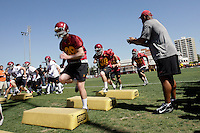 28 March 2009: Offensive players run drills during the first day of '09 USC Trojans Pac-10 college football spring practice on campus in Southern California on a hot 81' sunny day. Linebackers coach Ken Norton cheers them on.