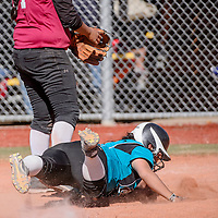 Navajo Prep Eagle Teniaya Lokeijack (19) dives home to score on the Shiprock Chieftains Saturday at the Gallup Sports Complex.