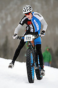SHOT 2/9/13 5:46:42 PM - Tim Allen (#239) of Golden, Co. tries to maintain his balance on a downhill section during the On-Snow Mountain Bike Crit event at the second annual Winter Mountain Games presented by Eddie Bauer at Vail Ski Resort in Vail, Co. Allen finished second in the Fat Tire Male class. The Winter Mountain Games feature competitions in X-Country On-Snow Mountain Bike Races, mixed climbing, Telemark Big Air,Best Trick Bike and On-Snow Mountain Bike Crit with more than $60,000 in prize money on the line. (Photo by Marc Piscotty / © 2013)