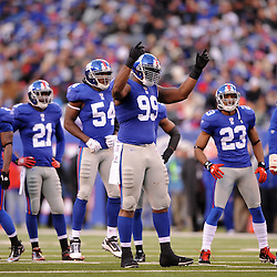 Defensive tackle Chris Canty #99 of the New York Giants pumps up the crowd during NFL football action between the New York Giants and Jacksonville Jaguars on Nov. 28, 2010 at MetLife Stadium in East Rutherford, N.J.