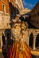 Woman in carnival costume, Bridge of Sighs, Venice Carnival (Carnevale di Venezia), Venice, Italy