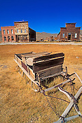 Wooden sleigh and store fronts on Main Street, Bodie State Historic Park, California USA