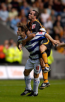 Fotball<br /> Foto: SBI/Digitalsport<br /> NORWAY ONLY<br /> <br /> Hull City v Queens Park Rangers<br /> Coca Cola Championship.<br /> 06/08/2005.<br /> <br /> Hull's Stuart Elliot (R) hitches a ride on the back of QPR's Gareth Ainsworth