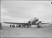 """9969-2919 """"Mainliner"""" plane of United Air Lines on its initial trip into Portland. It is a 21 passenger Douglas airplane. April 15, 1937. (Swan Island airport)"""