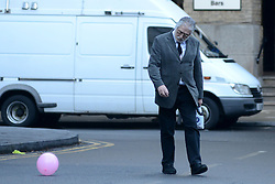 © Licensed to London News Pictures.16/01/2014. London, UK Former BBC Radio One DJ, Dave Lee Travis (David Patrick Griffin) looks at a balloon as he arrives at Southwark Crown Court. Travis is appearing in court, after being arrested at his home by the Metropolitan Police as part of Operation Yewtree, due to alleged sexual assaults during the 1970's and 80's during his time at the BBC. Photo credit : Peter Kollanyi/LNP
