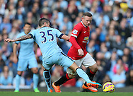 Wayne Rooney of Manchester United tackled by Stevan Jovetic of Manchester City - Barclays Premier League - Manchester City vs Manchester Utd - Etihad Stadium - Manchester - England - 2nd November 2014  - Picture David Klein/Sportimage