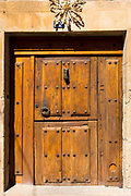 Traditional doorway with metal studs in Elciego in Rioja-Alavesa area of Spain