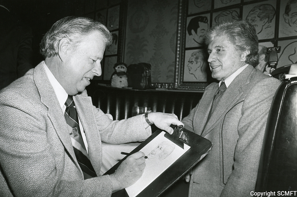 1978 Artist, Jack Lane sketches actor John Raitt for the Brown Derby Restaurant's Caricature Wall of Fame