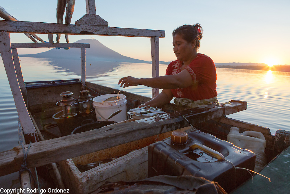 Soon after sunrise, Umikalsum, 41, brings his son's catch from the boat to the family home. She lives in Kubur Cina, a neighbordhood of Lewoleba, Nubatukan subdistrict, Lembata district, East Nusa Tenggara province, Indonesia.