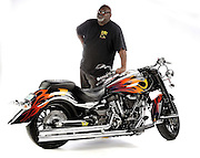 Drag racer & bike builder Tommy Bolton with a custom built Yamaha Warrior in studio on white background