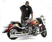 Drag racer & bike builder Tommy Bolton with a custom built Yamaha Warrior in studio on white background