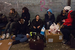 © licensed to London News Pictures. London, UK 29/11/2012. People waiting in a queue for Nintendo Wii U game console launch next to HMV Store in Oxford Street. Photo credit: Tolga Akmen/LNP