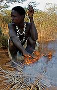 Hadzabe hunter at his fireplace. Lake Eyasi, northern Tanzania.
