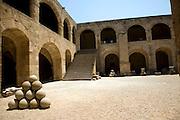 Stone sling shot balls, courtyard, Archaeological museum, Rhodes, Greece