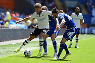 Lasse Vigen Christensen of Fulham (l) holds off Scott Malone of Cardiff city (r). .Skybet football league championship match, Cardiff city v Fulham at the Cardiff city stadium in Cardiff, South Wales on Saturday 8th August  2015.<br /> pic by Andrew Orchard, Andrew Orchard sports photography.